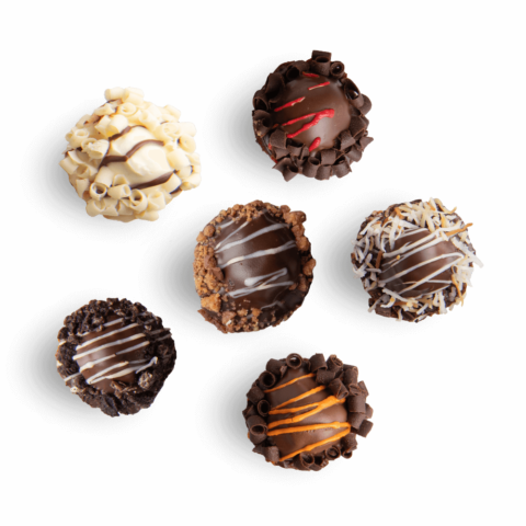 A birds-eye view of five mini fudge bombs in various flavors
