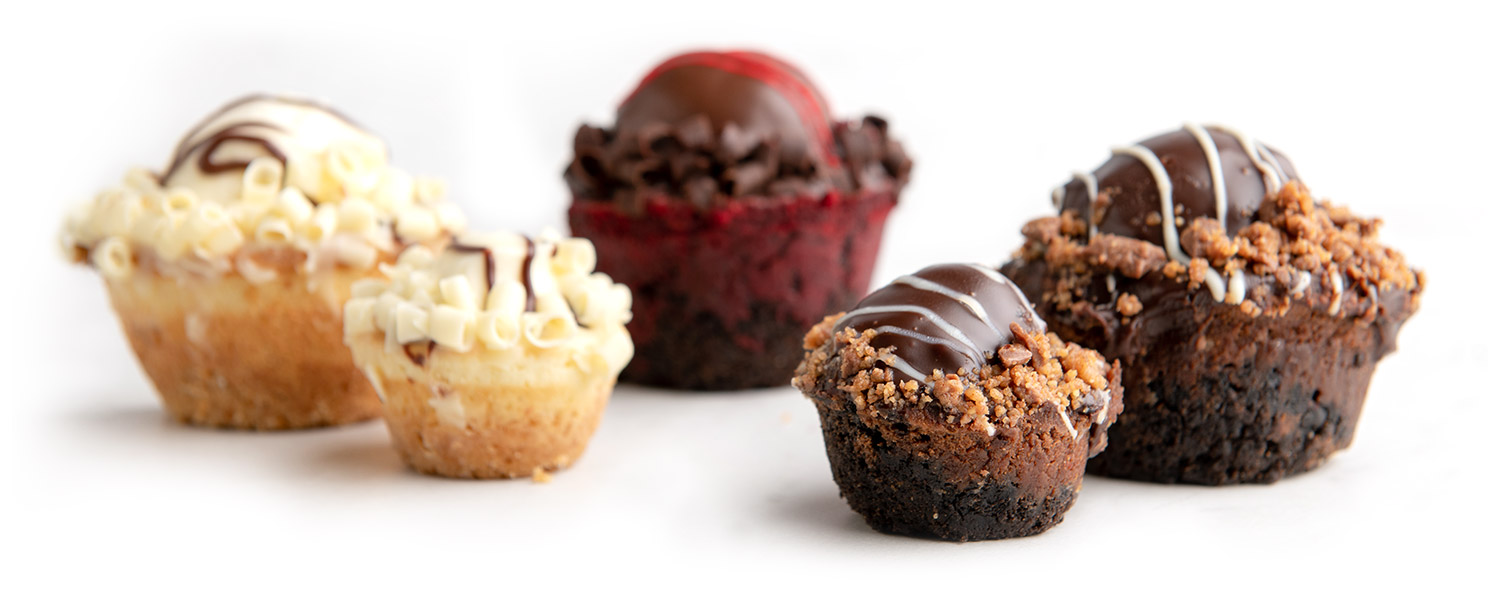 An arrangement of a variety of flavors of large and mini fudge bombs